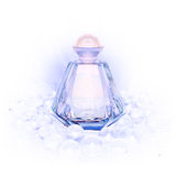 Perfume in a glass bottles and pearl beads on white. Royalty Free Stock Photos
