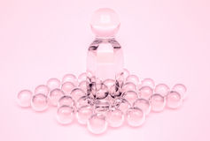 Perfume in a glass bottles and pearl beeds. Royalty Free Stock Images