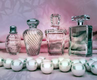 Perfume in a glass bottles and pearl on pink background. Horizontal vector illustration