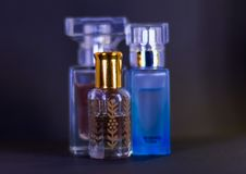 Perfume glass bottles placed together on table royalty free stock photo