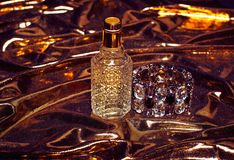 Perfume on gold background Royalty Free Stock Image