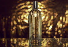 Perfume in gold bokeh. Bottle of perfume in gold bokeh Stock Images