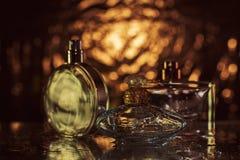 Perfume on golden glitering shine sparkle luxury bokeh dre Stock Image