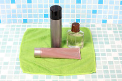 Perfume on green towel Stock Images
