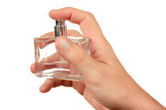Perfume in  hand Stock Images