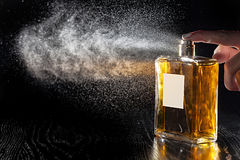 Perfume. Hand pressing aroma perfume bottle stock images