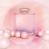 Perfume In A Glass Bottles And Pearl Beads On Pink. Stock Photo
