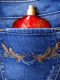Perfume In Jeans Pocket. Perfume Bottle in the back pocket of blue jeans Stock Images