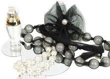 Perfume and jewelery Stock Photography