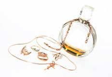Perfume and jewelry. On a white background Royalty Free Stock Photography