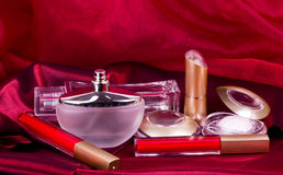 Perfume , lipstick and eyeshadow Stock Photography