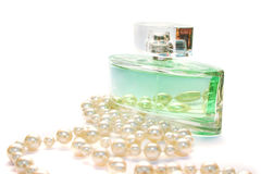 Perfume and necklace royalty free stock images
