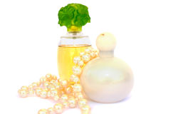 Perfume and necklace royalty free stock photography