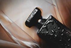 Perfume negro imágenes de archivo libres de regalías