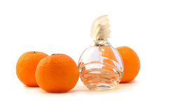 Perfume and oranges. Glass bottle of perfume and oranges Royalty Free Stock Images
