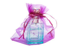 Perfume in a packing sack Royalty Free Stock Photos