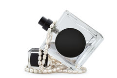 Perfume and pearls Stock Photos