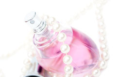 Perfume and pearls Stock Image