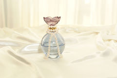 Perfume and pearls Royalty Free Stock Images