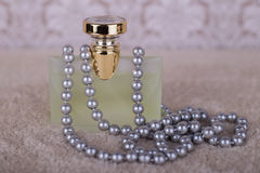 Perfume and pearls. Luxury perfume and string of pearls Stock Images
