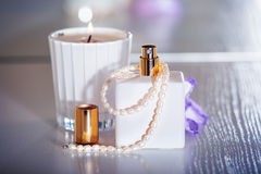 Perfume with pearls Stock Photo