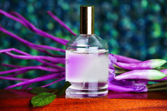 Perfume with pink flowers Stock Images