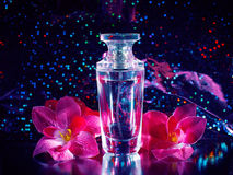 Perfume and pink flowers Stock Photos