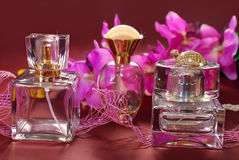 Perfume  and pink orchids Royalty Free Stock Images