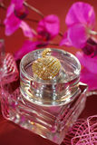 Perfume  and pink orchids Stock Images