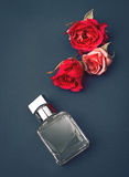 Perfume and red flowers Stock Image