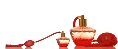 Perfume in a red glass bottles Royalty Free Stock Images