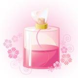 Perfume rosado del flor en botella de cristal transparente