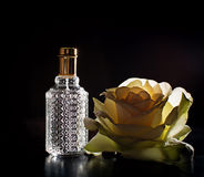Perfume and rose Stock Images