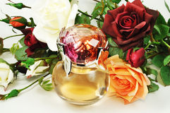 Perfume and roses Royalty Free Stock Photo