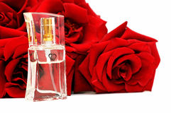 Perfume and roses Stock Images
