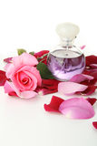 Perfume and roses petals Royalty Free Stock Photo