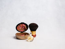 Perfume and rouge with a brush Stock Photography