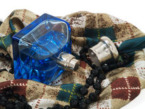Perfume, scarf and necklace Stock Photos