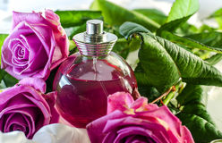 Perfume with the scent of roses Stock Photography