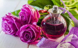 Perfume with the scent of roses Royalty Free Stock Photo