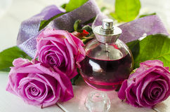 Perfume with the scent of roses Stock Images