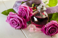 Perfume with the scent of roses Stock Photos