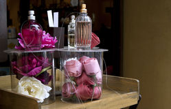 Perfume shop window with roses. royalty free stock photography