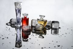 Perfume in small bottles. With ice Royalty Free Stock Image