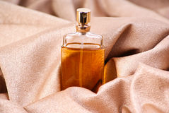 Perfume on textile Royalty Free Stock Photo