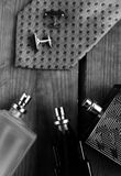 Perfume with tie and cuff. Men`s fashion accessories. Perfume with tie and cuff Stock Photo