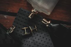 Perfume with tie and cuff. Men`s fashion accessories. Perfume with tie and cuff Royalty Free Stock Images