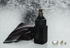 Perfume with tie and cuff. Men`s fashion accessories. Perfume with tie and cuff Stock Image