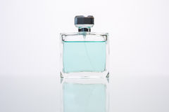 Perfume. Transparent bottle of perfume on a white background Stock Image
