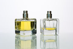 Perfume. Transparent bottle of perfume on a white background stock photos